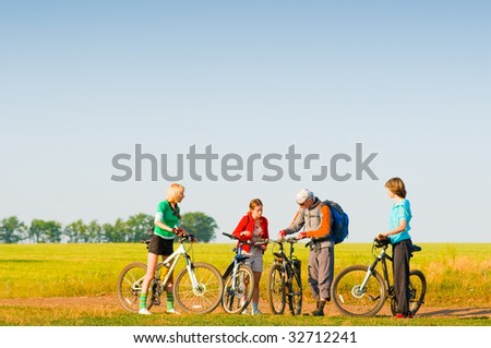 group of cyclists in field - stock photo