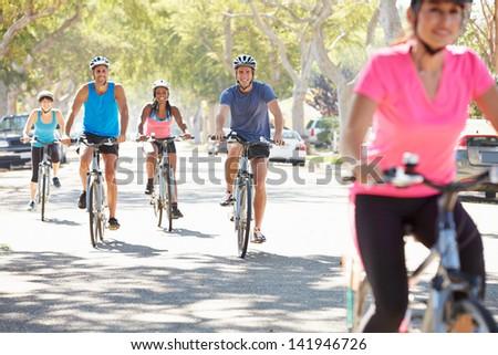 Group Of Cyclists On Suburban Street - stock photo