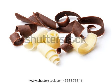 group of dark and white chocolate shavings isolated on white - stock photo