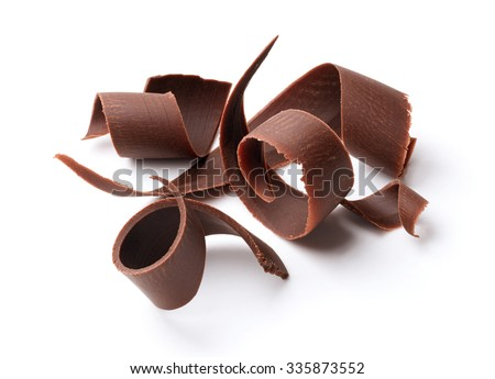 group of dark chocolate shavings isolated on white - stock photo