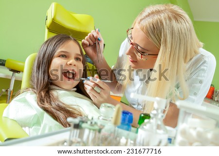 Group of dentists working at office together - stock photo