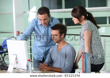 Group of designers in office - stock photo