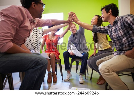 Group Of Designers Meeting To Discuss New Ideas - stock photo