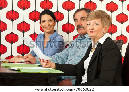 Group of different age of businesspeople at meeting in modern office - stock photo