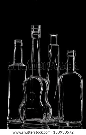 Group of different bottles with nice design on black. - stock photo