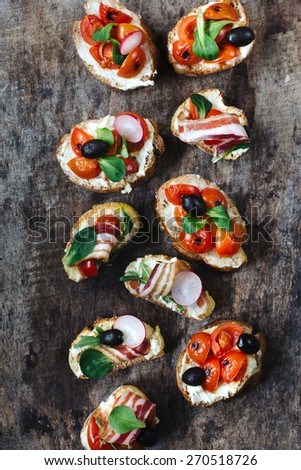 Group of different, bruschettas from above on wooden background,selective focus  - stock photo