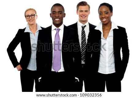 Group of different business people in a line posing and smiling at camera