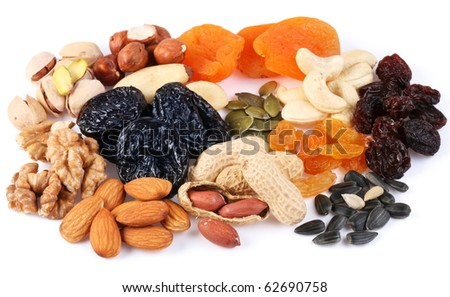 Group of different dried fruits and nuts on a white background.