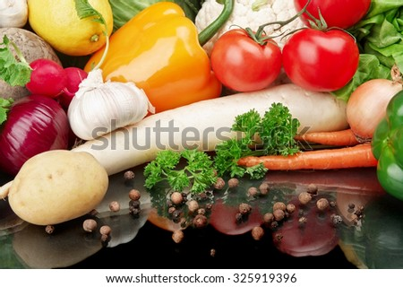 Group of different vegetables on black board
