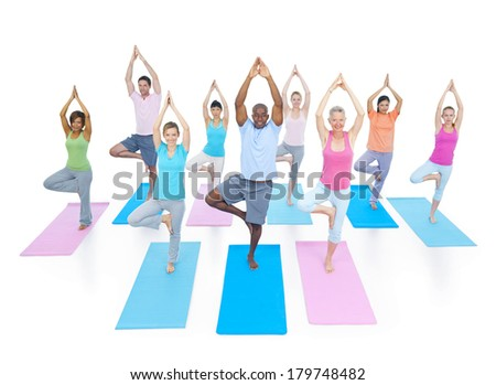 Group of Diverse Healthy People Doing Yoga - stock photo