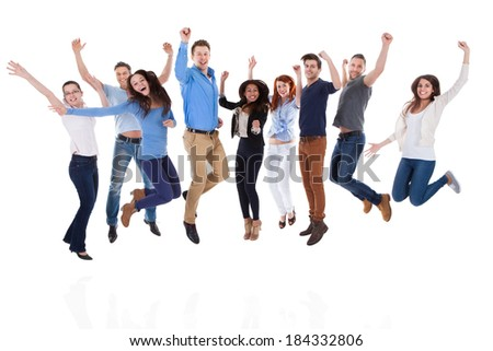 Group of diverse people raising arms and jumping. Isolated on white - stock photo