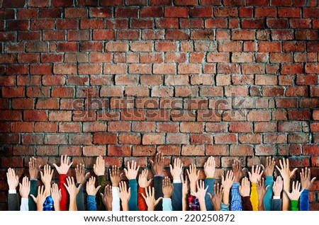 Group of Diverse People's Hands Raised - stock photo