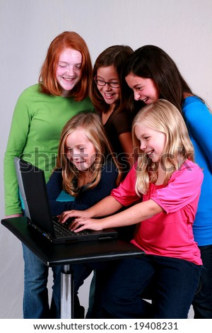group of diverse preteens on the internet - stock photo