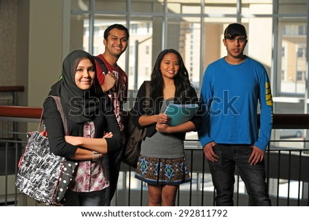 Group of diverse students inside school environment - stock photo