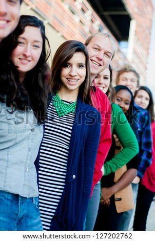 Group of  Diverse students outside smiling in a line - stock photo
