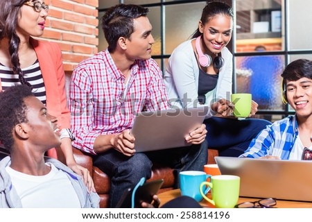 Group of diversity college students learning on campus, Indian, black, and Indonesian people - stock photo