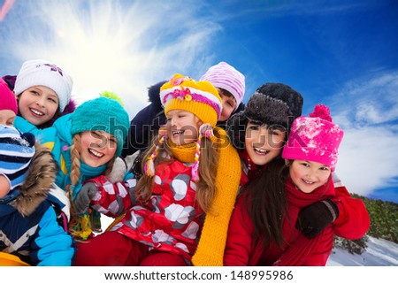 Group of diversity looking happy kids together on winter sunny day - stock photo
