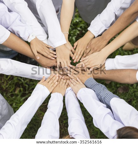 group of doctor or scientist team joining hands, bird's eyes angle view - stock photo