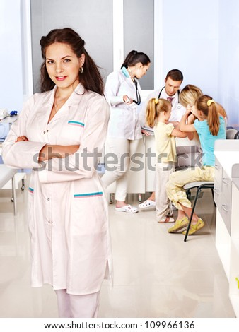 Group of doctor with child in hospital. - stock photo