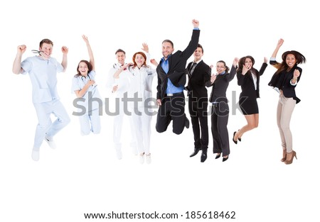 Group of doctors and managers jumping. Isolated on white - stock photo