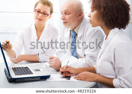 Group of doctors discuss work