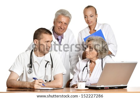 group of doctors discussing at the table