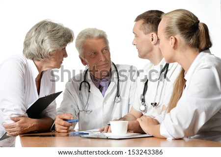 Group of doctors have a discussion at table - stock photo