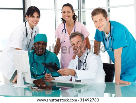 Group of doctors in a meeting looking at the camera - stock photo