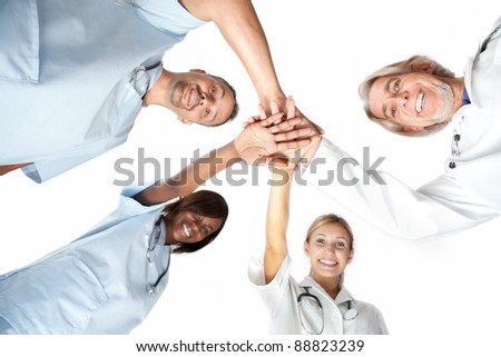 Group of doctors joining hands with low angle view.?? Isolated on white background