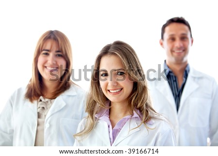 Group of doctors smiling isolated on white - stock photo