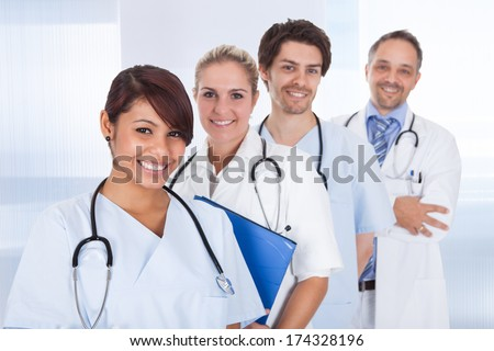 Group of doctors standing together at the clinic