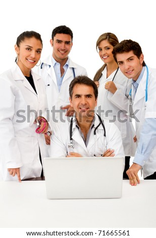 Group of doctors with a laptop ? isolated over white - stock photo