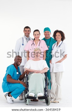 Group of doctors with a patient in a wheel chair - stock photo