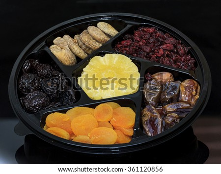 Group of dried fruit for Tu Bishvat holiday . Apricot, fig, palm, and plum, blueberry and pineapple - stock photo