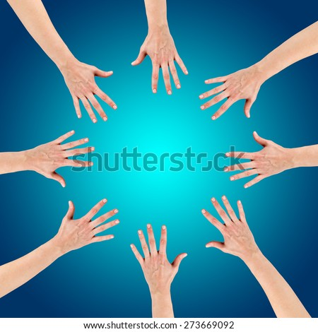 Group of eight hands at the circle together teamwork showing your product isolated on gradient blue background with copy space and clipping pass. Community concept - stock photo