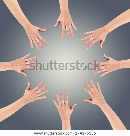 Group of eight hands at the circle together teamwork showing your product isolated on gradient grey background with copy space and clipping pass. Community concept - stock photo