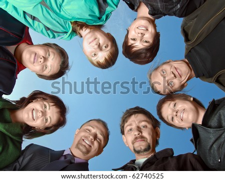 Group of eight people against the sky - stock photo