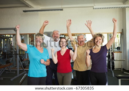 Group of elderly people having fun in gym - stock photo