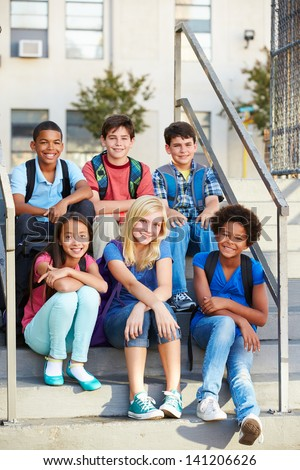 Group of Elementary Pupils Outside Classroom - stock photo