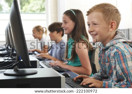 Group Of Elementary School Children In Computer Class - stock photo