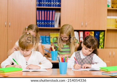 Group of elementary school pupils takes the test in class