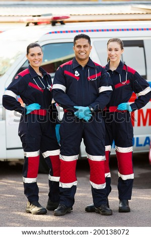 group of emergency medical service team in front of ambulance - stock photo