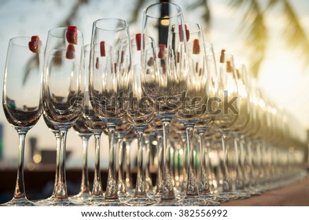 Group of empty cocktail glasses with hearth shape of watermelon on top preparing on table for party. - stock photo