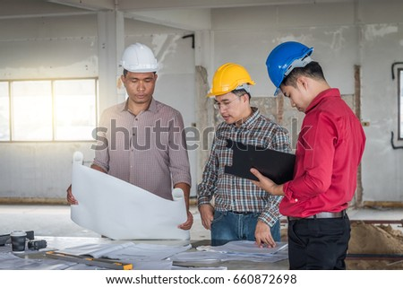 Group engineer checking blueprint on table stock photo 660872698 group of engineer checking the blueprint on the table and talking about construction project with commitment malvernweather Gallery