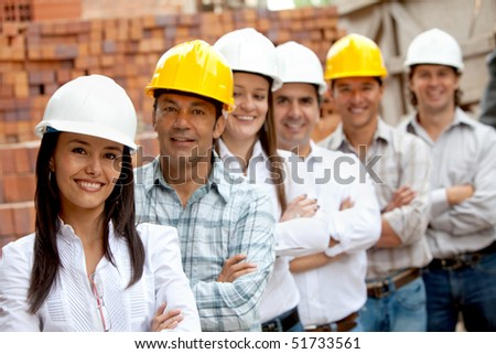 Group of engineer smiling in a construction site - stock photo