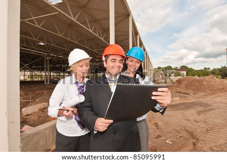 Group of engineers  at construction site - stock photo