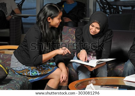 Group of ethnically diverse group of students studying - stock photo