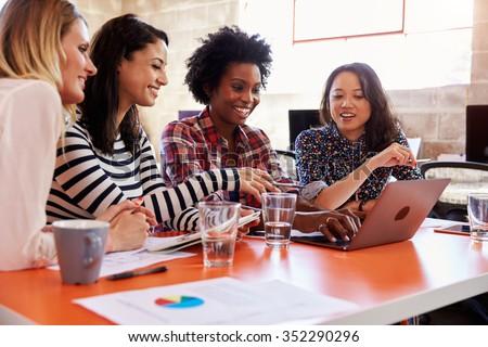 Group Of Female Designers Having Meeting In Modern Office - stock photo