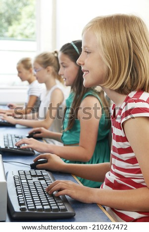 Group Of Female Elementary School Children In Computer Class - stock photo