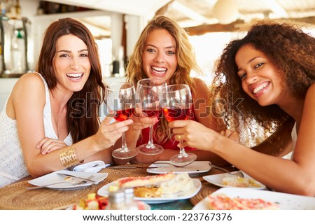 Group Of Female Friends Enjoying Meal In Outdoor Restaurant - stock photo